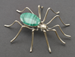 Spider pin, silver and malachite. Probably created by E. Spencer, Navajo artist, date unknown. On loan from Anne Coe Hayes. L.326.2015.6