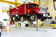 In-ground piston lifts enable wheels-free access to the vehicle.