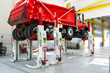 Wireless mobile column lifts eliminate tripping hazards and can be quickly moved around the shop floor.