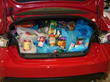 Trunk full of food from Subaru.