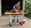 The Adjustable Height Work Station supports up to 500 lbs of weight, including the table top the user adds as their work surface.