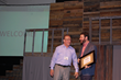 From left: Mike Wright recieves a Christian Marketplace Leadership award from AWOP president Chuck Proudfit.