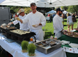 Local chefs from Taste of the Tetons demonstrate their culinary arts on Jackson Town Square (photo by Jackson Hole Chamber of Commerce).