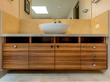 Wm. H. Fry Construction Co. won first place in the Residential Bath category in the 4th Annual PureBond® Quality Awards competition for its custom cabinetry featuring a zebrawood hardwood veneer.
