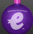 "EpilepsyStore.com is launching its ""Christmas in July"" event with a specially priced introductory offer of $14.95 for the set of two ornaments, which includes one each in purple and white."