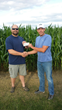 Cargill Donating Check -  Brandon Evans with the Badger Fire and Rescue  & Alan Viaene, Cargill Facility Manager at Fort Dodge.