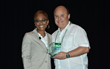 Charlie Ramirez (right) accepts his award from Shonda Anderson-Williams (left) General Manager, Microsoft SMB Central Region