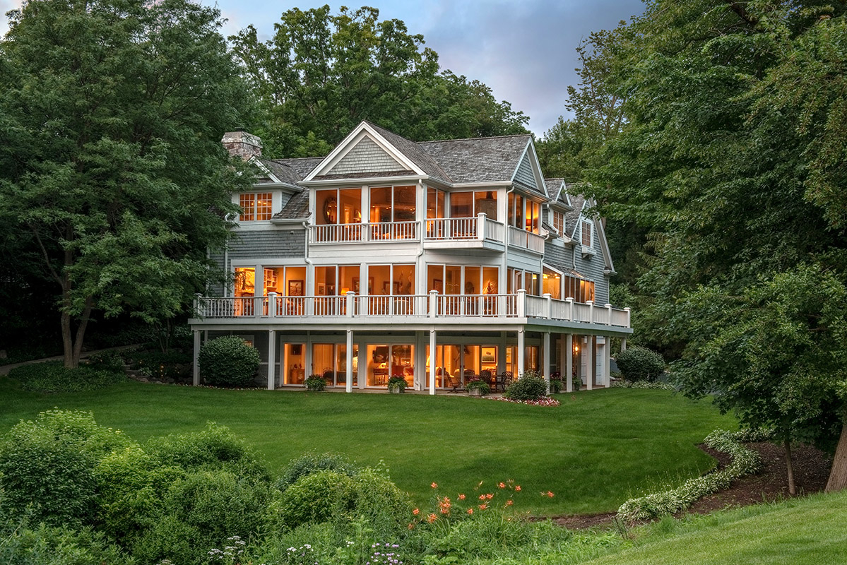Two luxury lake geneva waterfront homes to be sold at back for Lake front homes