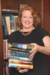 Janeen Culhane, activities assistant at Allerton House Assisted Living Community in Hingham, MA, provides more books for the club's consideration.
