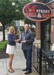 Front Flip CTO Chris Horsefield presents trophy to 54th Street's Kelly Reid