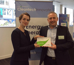 Dave Pearson is presented Star Renewable Energy's Cleantech Award by Alisa Murphy