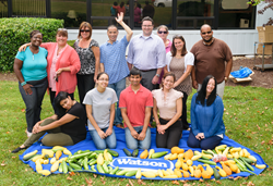 Watson Employees with the Food from their Gardens