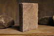 Saw-cut half cylinder test sample of Watershed Materials' new geopolymer masonry using natural clays. Test samples have achieved compressive strengths of 7,000 psi - twice the strength of ordinary con