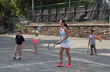Jamie Loeb instructs young tennis players from the Ossining Day Camp program on the Nelson Park Tennis Courts.