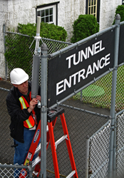 Dade Moeller employee Doug Draper, CHP, installs a radio-linked remote monitor at a tunnel entrance as part of the EPA's Environmental Response Team.