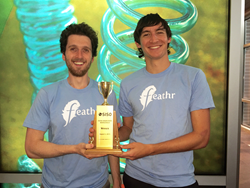 (image of Feathr co-founders holding trophy)
