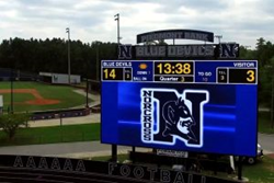 The largest sports facility video screen and scoreboard is at Norcross High School in Georgia.