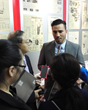 Chinese journalists interview Tasi Young, Director of Meridian School, during the event in Shanghai.