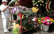 Selecting DIY flowers and supplies to make funeral arrangements