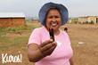 Kuros! pepper spray owner holding her new product
