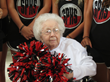 Pauline surrounded by fellow cheerleaders from South Point High School in Belmont, NC