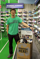 City Sports associate Nic Phinney with the Soles4Souls shoe donation box at the City Sports store on Franklin Street in Downtown Boston