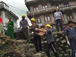 Nepali Scouts help chain rocks and other debris out of the sacred pond in Sankhu.
