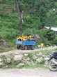 Climbing aboard a truck en route to a mountain village, Scientology Volunteer Ministers continue their project to demolish condemned buildings and create temporary shelter.