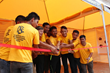 Cutting the ribbon of the new Volunteer Ministers tent in Kathmandu, the Scientology Goodwill Tour leader is joined by recent graduates trained at the new Volunteer Ministers Nepal headquarters.