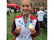 Baylee Scharf with 2 of the 6 medals she won at the 2015 Maccabi Games in Berlin Germany