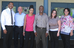 Axiom Bank employees deliver hygiene kits and other donations to Rescue Outreach Mission.