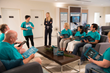 Volunteers meet at the Foundation for a Drug-Free World center in Clearwater, Florida, to plan activities to bring the program to the community.