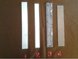 Recalls that after 60-90 minutes in solutions of KOH and NaOH oxide, film on plates #3 and # 4 stops the oxidation of the active metal, while plate #2 remains free of oxidation. (#1 is the control age