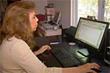 Author Rhonda Rees at her computer