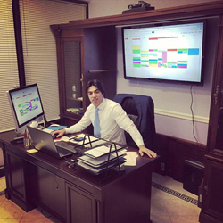 Paul Panah Ibrahimov is working in his office.