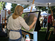 A QuickDraw artist paints in the open air during one of the festival's most popular events, scheduled for Sept. 19, 2015, on Jackson Town Square.