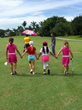 Girls aged 7-9 walk to the next hole on St. Andrews Country Club's Palmer Course as they compete for awards and prizes.