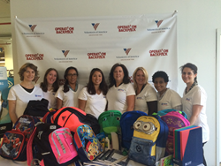 CREW New York members spent time ensuring backpacks were filled with age-appropriate school supplies during Volunteers of America's Sort Day for Operation Backpack.