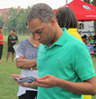 At a National Night Out event in Washington, D.C. August 4, 2015, a man reads one of the Truth About Drugs booklets that gives the facts about heroin and heroin abuse.