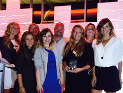 The Epiphany Learning team, including Founder and CEO Laura Henderson (pictured with the People's Choice Wisconsin Innovation Award).