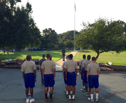 Postgraduate basketball players reported to Fork Union Military Academy yesterday and ended the day with Retreat Formation to retire the colors.