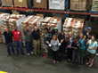 Members of the Second Harvest Food Bank hold up the peaches they will soon be delivering