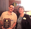 Jarett Rhoads (left) received service recognition plaque from NYSATA President Aimee Brunelle