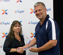 xTuple CEO Ned Lilly presents 2015 Partner of the Year Award to U.S.-based ERP Implementation Consulting Group (ERPICG), Andrea Knight accepting.