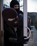 Home being broken into by residential burglars.