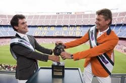 Sydney 2000 Olympic Jumping gold medallist and current World European champion Jeroen Dubbeldam (NED), right, and Sergio Álvarez Moya (ESP) wrestle with the Furusiyya trophy at Barcelona FC