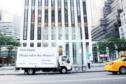 #WeAre6S billboard in outside the Apple Store in New York City