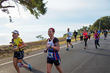 Marathon runners race along Scenic Highway overlooking Pensacola Bay.