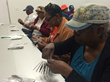 "Senior citizens participate in a ""What Happened Today?"" community workshop, 2015. Photo by Blaize Middleton."