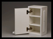 The cabinet comes in white with slides on the side for linking and two adjustable shelves.